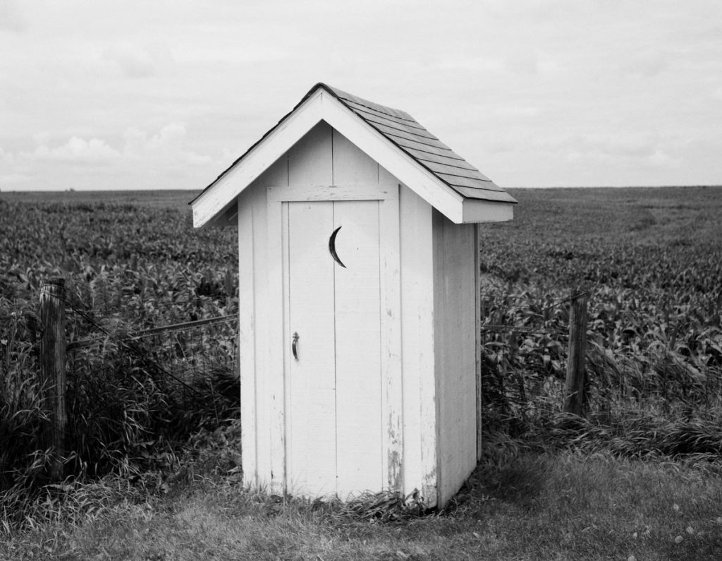 Privy along a field