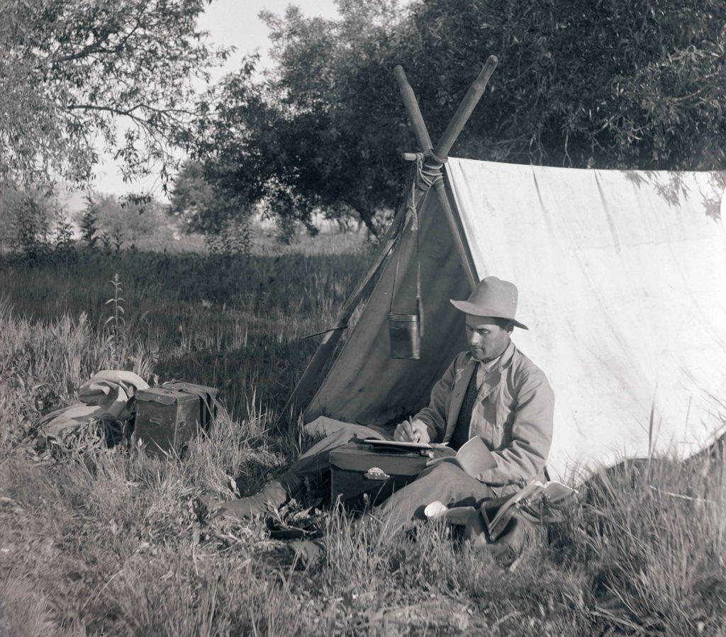Klamath River Tent Man Writing Journal