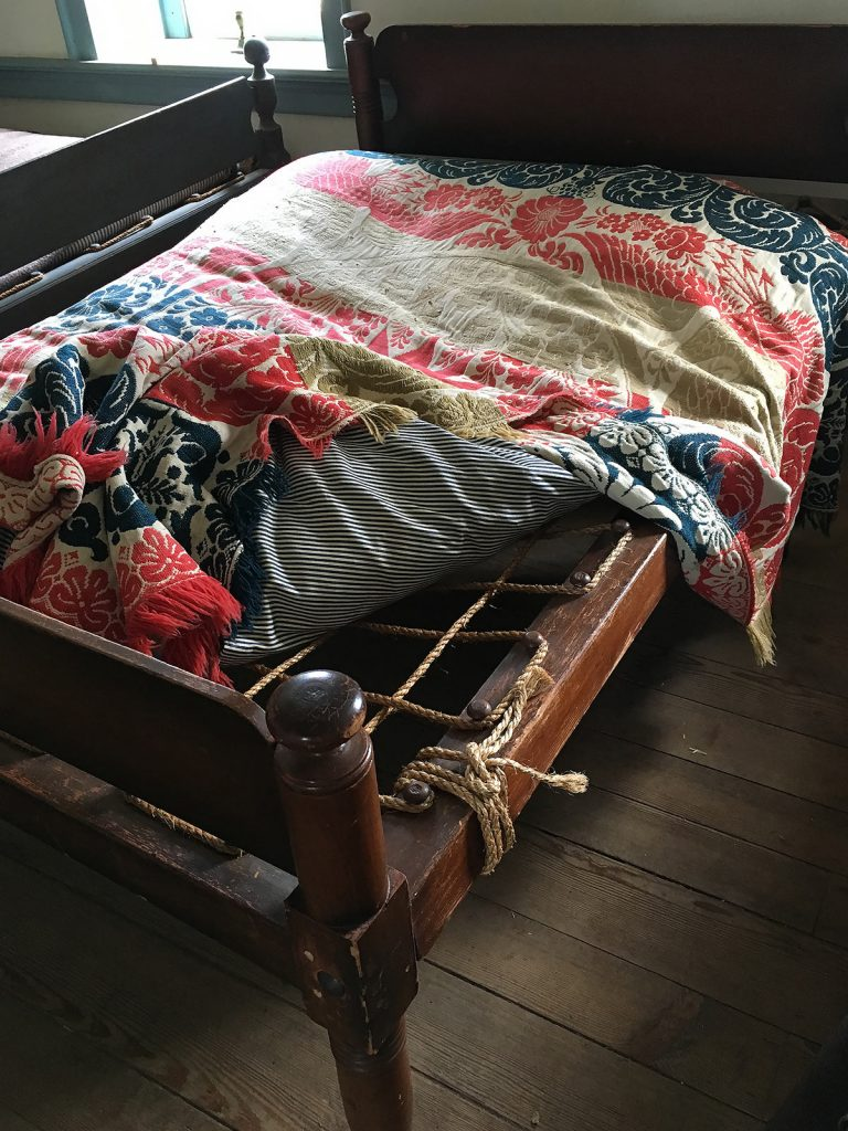 Double rope bed with coverlet