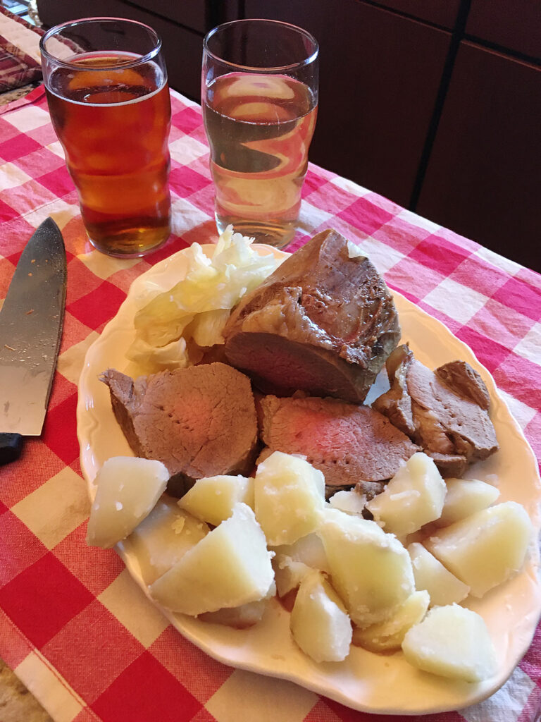 Boiled beef, potatoes, cabbage, and beer